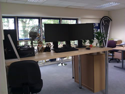 The finished desk, complete with cuddly toy mascots.